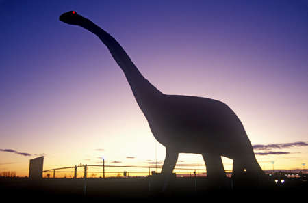 Silhouette of statue of Brontosaurus, SD at sunset