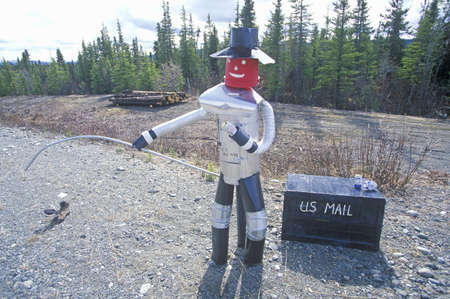 Statue of fisherman created of tin cans by mailbox, AL Sajtókép