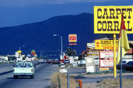 advertise with us: Roadside signs and billboards at entrance to Hesperia, CA Editorial