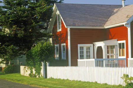 Red home with white picket fence, Mendocino, CA