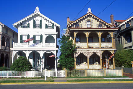 Victorian homes with white picket fences from street, Cape May, NJ