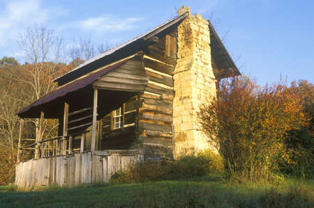 tn: Exterior of Log Cabin with fireplace and porch, TN Editorial