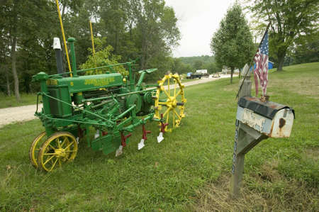 Antique John Deere tractor in front of yard along Manchester Road, Missouri