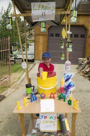 A little boy sells lemonade at a lemonade stand in Pine Mountain Club, California Stock Photo - 20766406