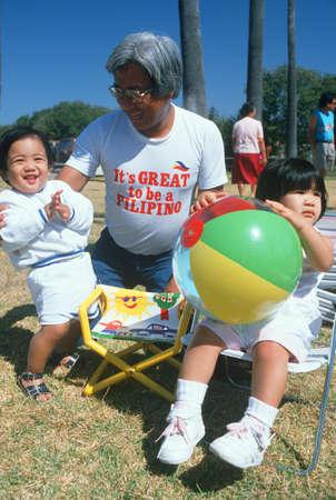 kinship: Filipino grandfather with his grandchildren, Santa Barbara, CA