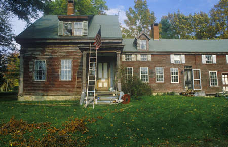 Front exterior of rundown home,  New England