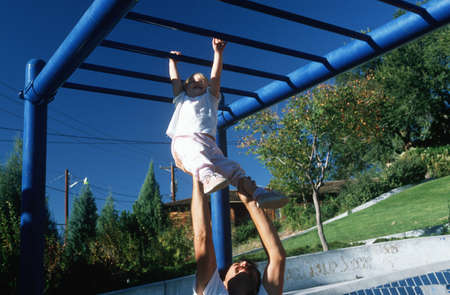 jungle gym: A father and daughter playing on the jungle gym, Albaquerque, NM