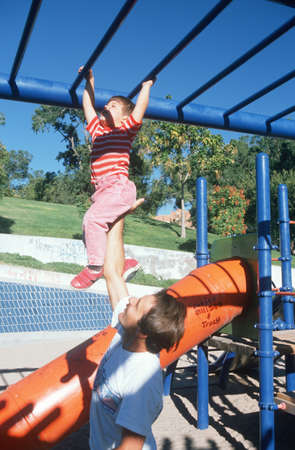 jungle gym: A father and daughter playing on the jungle gym, Albequerque, NM Editorial