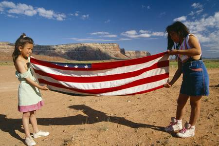 ut: Two girls folding the American flag, Lee Ranch, UT Editorial