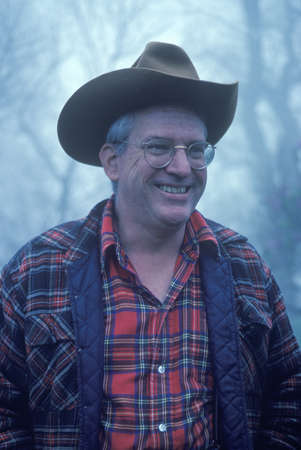 flannel: A man in a cowboy hat and flannel shirt smiling, Monticello, VA Editorial