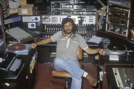 the narrator: Radio disc jockey for station KFI in his studio, Los Angeles, CA