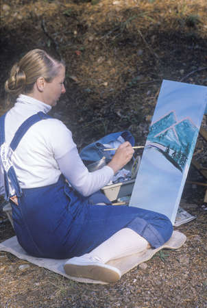 nm: An art student painting a scenic, Santa Fe, NM