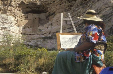 dwelling: An artist doing a sketch of Montezumas Castle cliff dwelling, AZ