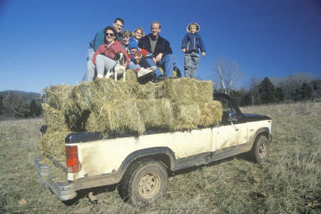 photographies: A family sitting on hay bales, Bourbon,MO