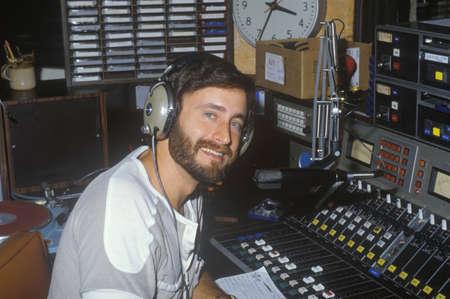 narrator: Radio disc jockey for station KFI in his studio, Los Angeles, CA