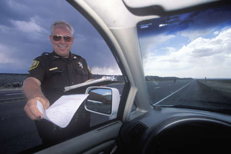 patrolman: Highway patrolman gives a speeding ticket