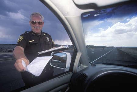 tickets: Highway patrolman gives a speeding ticket