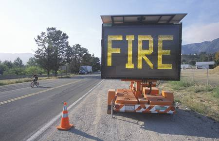 Flashing highway sign: Fire