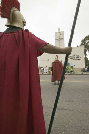 Roman Solider reenactors holding back crowd on Good Friday, Easter, during the Passion play, a dramatic reenactment of the trial, torture and death of Jesus Christ at Christ the King Church and Our Lady of Guadalupe Parish, Oxnard, California, April 6, 20 Stock Photo - 20801573