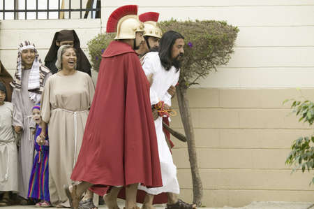 An actor portraying Jesus Christ being brought to trial on Good Friday, Easter, during the Passion play, a dramatic reenactment of the trial, torture and death of Jesus Christ at Christ the King Church and Our Lady of Guadalupe Parish, Oxnard, California,