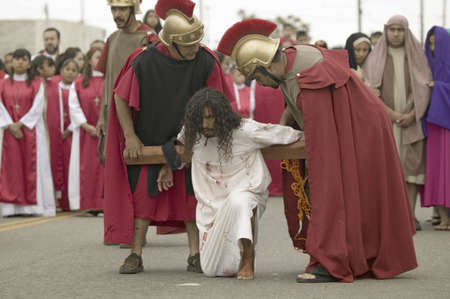 roman soldiers: Roman soldiers overseeing reenactment of Jesus Christ carrying a cross on Good Friday, Easter, during the Passion play, a dramatic portrayal of the trial, torture and death of Jesus Christ at Christ the King Church and Our Lady of Guadalupe Parish, Oxnard