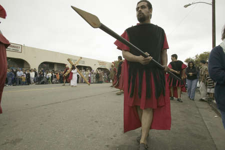 roman soldiers: Roman soldiers with spears marching down street on Good Friday, Easter, as part of the Passion play, a dramatic reenactment of the trial, torture and death of Jesus Christ at Christ the King Church and Our Lady of Guadalupe Parish, Oxnard, California, Apr