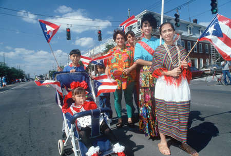 puerto rican flag: A Puerto Rican family with their national flag at a parade, Wilmington, DE