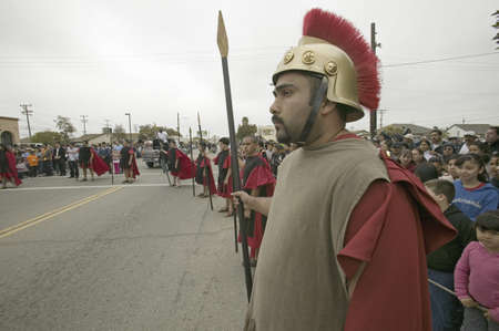 Roman Solider reenactors holding back crowd on Good Friday, Easter, during the Passion play, a dramatic reenactment of the trial, torture and death of Jesus Christ at Christ the King Church and Our Lady of Guadalupe Parish, Oxnard, California, April 6, 20 Stock Photo - 20801605