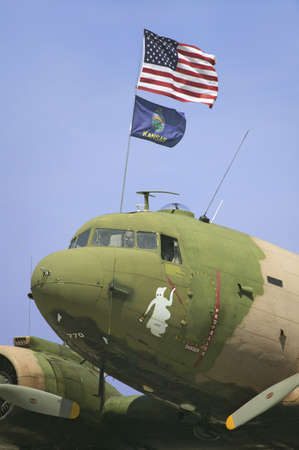 42nd: Vintage World War II C-47 Cargo Plane with Casper the Ghost, and American and Kansas State Flag, at the 42nd Naval Base Ventura County (NBVC) Air Show at Point Mugu, Ventura County, Southern California.