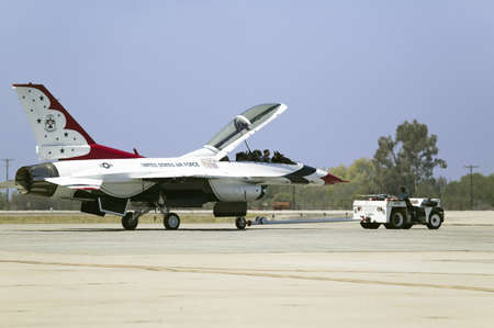 A F-16C Fighting Falcons, known as the Thunderbird, resting with it's cockpit open at the 42nd Naval Base Ventura County (NBVC) Air Show at Point Mugu, Ventura County, Southern California.