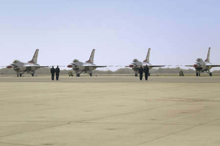 US Air Force pilots standing at attention in front of their F-16C Fighting Falcons, known as the Thunderbirds before flying at the 42nd Naval Base Ventura County (NBVC) Air Show at Point Mugu, Ventura County, Southern California.