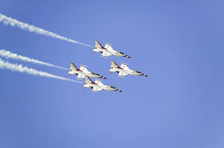 42nd: Four US Air Force F-16C Fighting Falcons, known as the Thunderbirds, flying in formation with white trailer of smoke over the 42nd Naval Base Ventura County (NBVC) Air Show at Point Mugu, Ventura County, Southern California.
