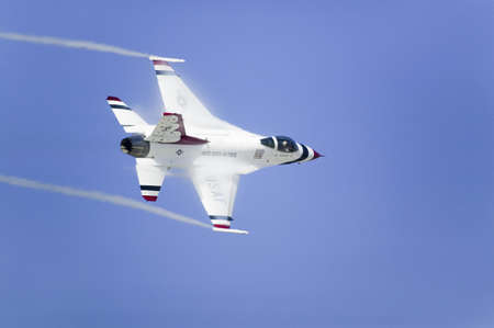 US Air Force F-16C Fighting Falcons, known as the Thunderbirds, flying in blue sky over the 42nd Naval Base Ventura County (NBVC) Air Show at Point Mugu, Ventura County, Southern California.