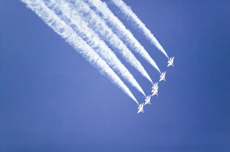 Six US Air Force F-16C Fighting Falcons, known as the Thunderbirds, flying in formation with white trailer of smoke over the 42nd Naval Base Ventura County (NBVC) Air Show at Point Mugu, Ventura County, Southern California.