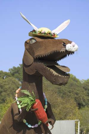 tyrannosaur: Roadside street art of an Easter Dinosaur holding carrot in Oak View, California.