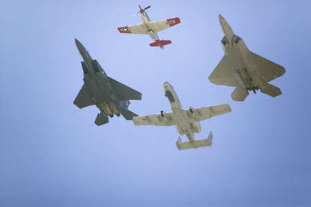 United States Air Force on its 50th anniversary featuring heritage flight with four vintage planes, the P-51 Mustang, F-22 Raptor, A-10A Thunderbolt II, and F-15E Strike Eagle at the 42nd Naval Base Ventura County (NBVC) Air Show at Point Mugu, Ventura Co