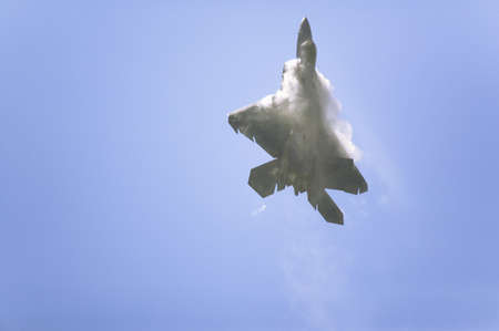 US Air Force F-22A Raptor Jet Fighter making extreme turn at the 42nd Naval Base Ventura County (NBVC) Air Show at Point Mugu, Ventura County, Southern California.