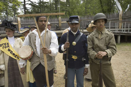 Past and present African American soldiers posing as part of the 400th anniversary of the Jamestown Colony, Virginia, attended by Her Majesty Queen Elizabeth II at the James Fort, Jamestown Settlement, May 4, 2007