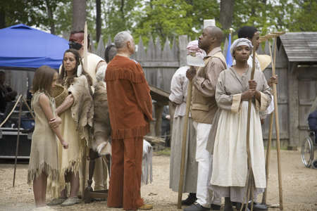 Native Americans and African slave reenactors posing as part of the 400th anniversary of the Jamestown Colony, Virginia, attended by Her Majesty Queen Elizabeth II at the James Fort, Jamestown Settlement, May 4, 2007 Redactioneel