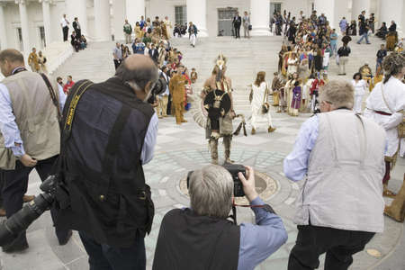 american media: National Press photographing American Indian in front of Virginia State Capitol, Richmond Virginia, and State Seal during ceremonies for the 400th Anniversary of the Jamestown Settlement on May 3, 2007