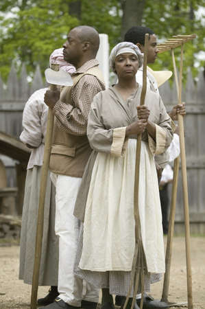 attended: African slave reenactors posing as part of the 400th anniversary of the Jamestown Colony, Virginia, attended by Her Majesty Queen Elizabeth II at the James Fort, Jamestown Settlement, May 4, 2007