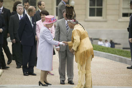 Her Majesty Queen Elizabeth II, Queen of England and the Duke of Edinburgh, Prince Philip and Virginia Governor Timothy M. Kaine meeting Native American Indian Ceremony and Powhatan Tribal Member in front of Virginia State Capitol, Richmond Virginia as pa Editorial