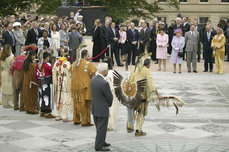 l first: Her Majesty Queen Elizabeth II, Queen of England and the Duke of Edinburgh, Prince Philip, Virginia Governor Timothy M. Kaine, First Lady Anne Holton and former Governor L. Douglas Wilder observing Native American Indian Ceremony featuring Powhatan Tribal Editorial