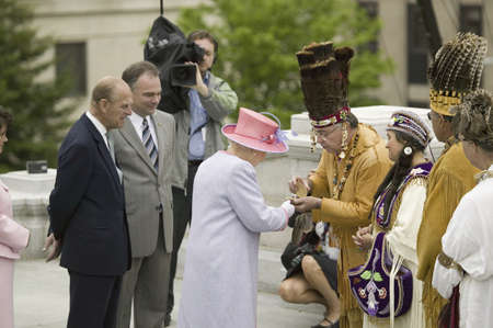 Her Majesty Queen Elizabeth II, Queen of England and the Duke of Edinburgh, Prince Philip receiving gift from Native American Indian Ceremony and Powhatan Tribal Member in front of Virginia State Capitol, Richmond Virginia as part of the 400th anniversary Editorial