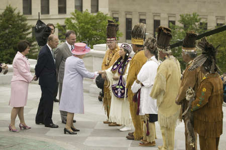 Her Majesty Queen Elizabeth II, Queen of England, the Duke of Edinburgh, Prince Philip, Governor Timothy M. Kaine and his wife Anne Holton meeting Native American Indian Ceremony and Powhatan Tribal Member in front of Virginia State Capitol, Richmond Virg