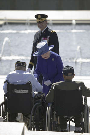 Her Majesty Queen Elizabeth II interacting with World War II Disabled Veterans at the National World War II Memorial, Washington, DC, May 8, 2007