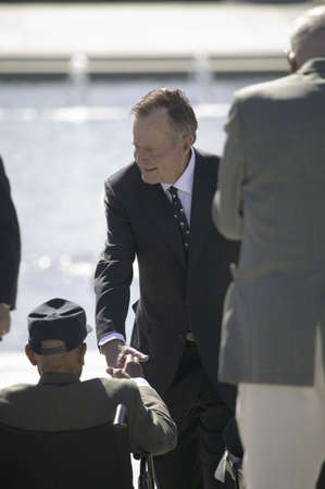 Former President George H.W. Bush interacting with World War II disabled Veterans at the National World War II Memorial, Washington, DC, May 8, 2007 Stock Photo - 20802973