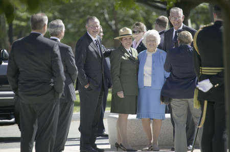 Former President George H.W. Bush and Barbara Bush posing for camera in front of National World War II Memorial, Washington, DC, May 8, 2007