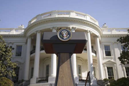 portico: Presidential Seal on podium in front of the South Portico of the White House, the Truman Balcony, in Washington, DC on May 7, 2007, in preparation for the visit of Her Majesty Queen Elizabeth II and President George W. Bush Editorial