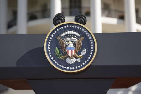 presidential: Presidential Seal on podium in front of the South Portico of the White House, the Truman Balcony, in Washington, DC on May 7, 2007, in preparation for the visit of Her Majesty Queen Elizabeth II and President George W. Bush Editorial